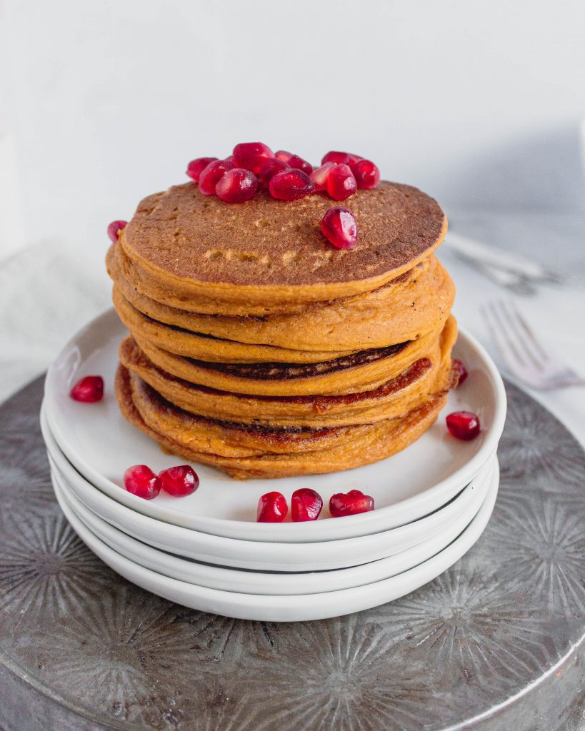 Healthy Pumpkin Oat Pancakes, made with pumpkin puree, oat flour, arrowroot flour, and maple syrup.