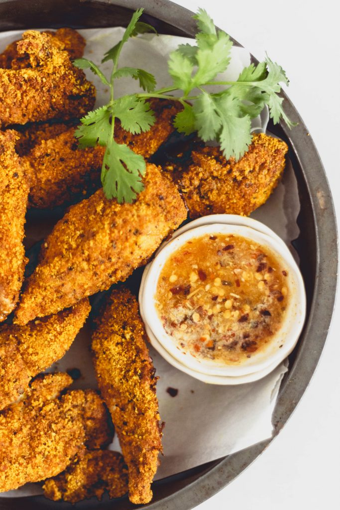 Healthy baked almond flour chicken fingers that are crispy and delicious - no deep frying or breading required. Dip them in hot honey dipping sauce or add to a caesar salad for a delicious weeknight dinner that is ready in 30 minutes.