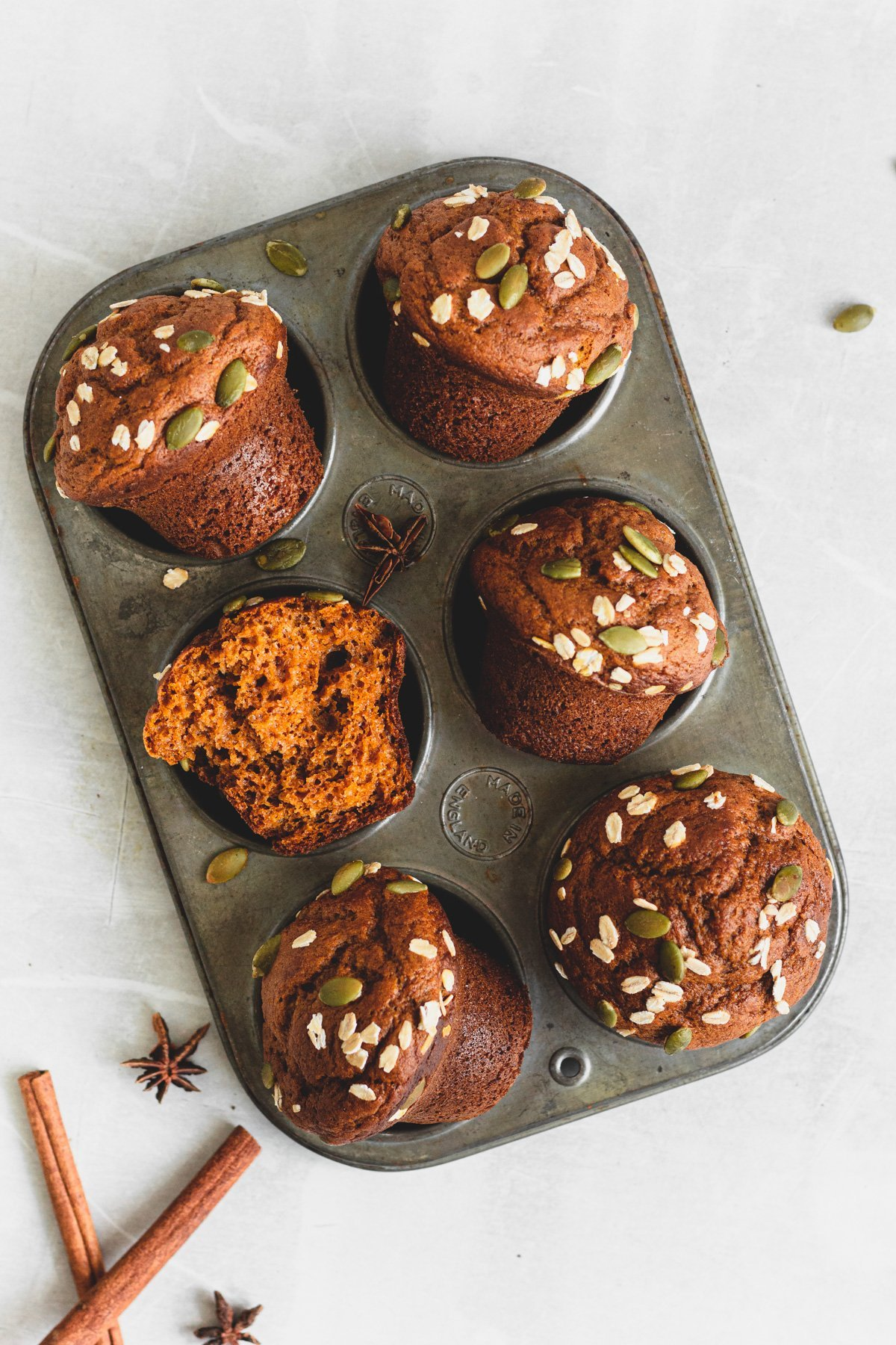 6 sourdough pumpkin muffins in muffin tin, from overhead